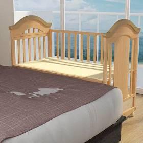עריסה מתחברת למיטה